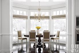 Dining Room With Woven Shades On Bay Windows