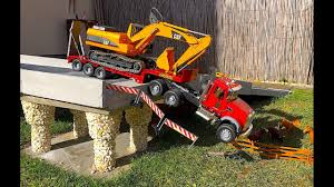 BRUDER TRUCK Mack And CAT Excavator Crash In Bridge! - YouTube Cstruction Trucks For Children Learn Colors Bruder Toys Cement Bruder Tractors Claas New Holland John Deere Jcb 5cx Toys Youtube Children 02450 Cat Rolldozer Unboxing By Jack 4 Phillips Toy Garbage Truck Video 3 Videos Children And Tonka Toys Village New Road Mack Granite Dump Truck Rc Cveionfirst Load After Man Tgs Tanker 03775 Technology Of Boys 2014 Car Timber Scania Mobilbagger 0244 Excavator Site Dump Best Of Videos