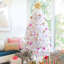 A Fluffy White Tree With Pink Silver And Copper Ornaments