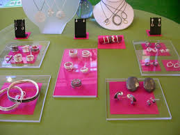 Pink Fabric Is Strategically Placed Beneath Rectangles Of Plexiglass On This Jewelry Display Table At Craftland