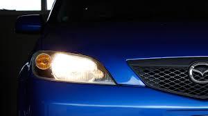 simple how to change headlight bulbs mazda 2 demio