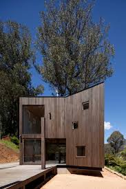 Small Holiday Home With An Open Plan Design In Melbourne, Australia Ian Macdonald Hides Ontario Island Cottage Within A Forest Contemporary Holiday Home Hidden Behind A Dune Slope Crafty And Compact Holiday Home Design Cpletehome 7 Brutalist Homes You Can Rent Swedish Designed By Tham Videgrd Arkikter Architectural Designs For Amusing Fresh Rosehill Cottage The Good Design Best At Containerlike Bach In Coromandel Gallery Of Tth Project Architect Office 2 Casa Reitani Italy Bookingcom Oceanfront Yzerfontein South Africa