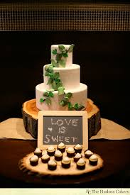 Rustic Wedding Cake Sits On Top Of Our Tree Trunk Base Sugar Leaves Are Multi Colored For A Natural Look