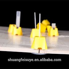 Floor Tile Leveling Spacers by Tile Leveling System Ceramic Leveling And Install Tools Lippage