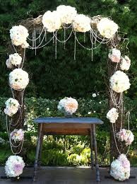 Natural Rustic Wedding Arch Flowers Designs Combined With Dark Brown Roots And Beautiful White