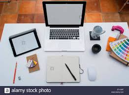 Creative Home Office Space With Graphic Designers Desk Laptop Against A Brick Wall
