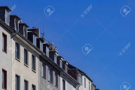 100 Attic Apartments A Whole Row Of Attic Apartments And Blue Sky In Dusseldorf
