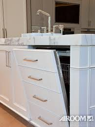 A High End Dishwasher Hides Inconspicuously Behind Drawer Facade In The Island Of This Winnetka IL Kitchen