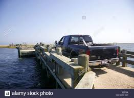 Trucking Crossing Dike Bridge, Chappaquiddick Island, Martha's Stock ... Trucking Transportation New England Motor Freight Nemf Rays Truck Photos Are You Ready For A Job With Cr Driving Work Ltl Carrier California To Drivers Of Google Logo Land Air Express Office Photo Glassdoor Driver Traing Hvacr And Industry Ag Excel In Championships Progressive Grocer The Company Inc Specialists Services S J Companies Best 2018