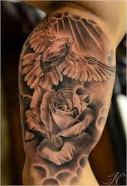 Man Showing Her Dove And Grey Rose Tattoo