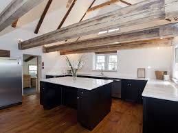 Rustic Luxe Kitchen With Broad Exposed Beams Wide Plank Floor Scraped Paint Black Industrial