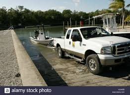 Two Employees Using Pickup Truck To Put Boat Into Water At Boat Ramp ... Atv Loading Ramp Review Comparing Folding Ramps And 2piece Snowmobile Truck Ramp Youtube Ramps Steel For Pickup Trucks Trailers Extreme Max Dirt Bike 2019 Events Handiramp M200 Pickup Truck Discount 94 X 54 Solid Surface Trifold Heavyduty Alinum Trailer Receivers Gemplers Old For Sale Upcoming Cars 20 Two Employees Using Pickup To Put Boat Into Water At Qatar Living Product Test Madramps Wheels Magazine