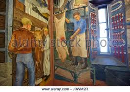 fresco murals inside coit tower showing a scene of city life san