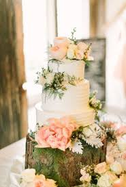 White Wedding Cake With Light Pink Flowers