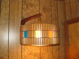 wall l with electrical cord with orbit wall sconce light