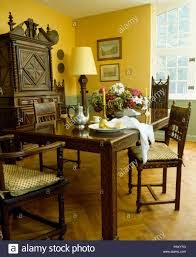 Carved Wooden Table And Chairs In French Country Dining Room ... 100 French Country Ding Room Fniture Old Amazoncom Baxton Studio Laurence Cottage 5 Country Ding Room Beamed Ceiling Stable Door Table In Layjao Pair Ethan Allen Ladder Back Arm Charming Decor Ideas For Your Home Chairs White Set Wwwxandfiddlecaliforniacom Vase Of White Roses On Set Lunch With Plates 19 Examples Dcor Fniture Decoration Designs Guide Style Tables Sydney Parquetry Elm Timber