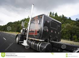 Black Classic Big Rig Semi Truck With Vertical Pipes Going On Wi ...