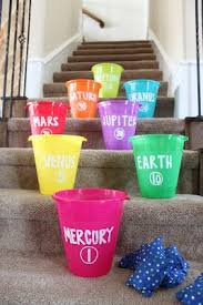 Game A Fun Planet Toss On The Stairs With Bean Bags And Buckets