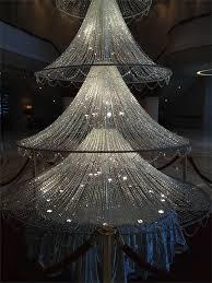 A Fifteen Foot Crystal Christmas Tree Standing Under Huge Swarovski Chandelierin The Lobby Of HotelHarbour Grand In Hong Kong