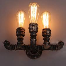 industrial pipe wall sconce in bronze copper finish with edison