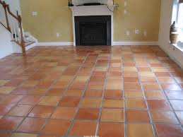 exciting saltillo tile with white baseboard and fireplace mantle