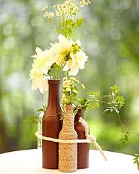 Different Height Wine Bottles Painted Wrapped In Rustic Adornments Im CenterpiecesCenterpiece IdeasWedding