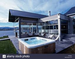 100 Modern Architectural House Butterfly Chairs And Hot Tub On Decking Outside Modern Architectural