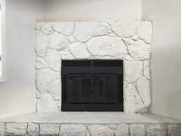 Simply white painted rock fireplace change or leave alone