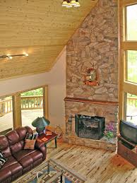 Towering Stone Fireplace LOVE Quailrun Rustic Acadian Home Great Room Photo From