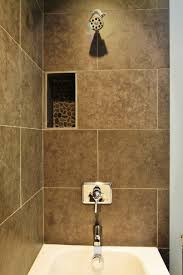 large format tile with pebble niche accent traditional