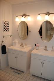 Marvellous Vanity Lighting Small Bathroom Ceilings Above High ... Bathroom Picture Ideas Awesome Master With Hardwood Vanity Lighting And Design Tips Apartment Therapy Menards Wattage Lights Fixtures Lowes Nickel Lamp Home Designs Bronze Light Mirrors White Double Delightful Two For And Black Wall Modern Model Example In Germany Salt Lamps Photos Houzz Satin Rustic Style Exquisite Fixture Your House Decor