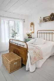 Sweet French Country Styled Bedroom With Gray Painted Wide Plank Floors And A Shiplap Ceiling