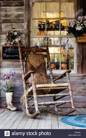 Old Wooden Rocking Chair On A Wooden Porch Stock Photo ... Whosale Rocking Chairs Living Room Fniture Set Of 2 Wood Chair Porch Rocker Indoor Outdoor Hcom Traditional Slat For Patio White Modern Interesting Large With Cushion Festnight Stille Scdinavian Designs Lovely For Nursery Home Antique Box Tv In Living Room Of Wooden House With Rattan Rocking Wooden Chair Next To Table Interior Make Outside Ideas Regarding Deck Garden Backyard