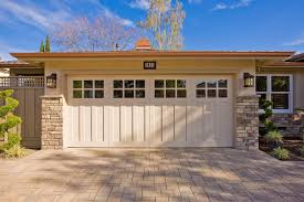 Craftsman Style Garage Doors And Shed With Driveway Paved Stone