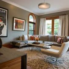 Fab Light Fixture And Rug Mute The Honey Oak Trim In This Living Room
