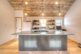 Rustic Kitchen With Hardwood Floors Concrete Counters Built In Bookshelf Verdicrete Engineered