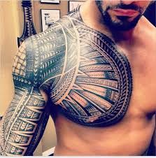 Tribal Chest And Sleeve Tattoo