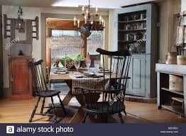 Rustic Style Dining Room With Corner Cabinet And Pewter Items USA