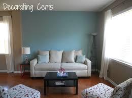 Interior Design Unique Blue Living Room Wall With Sunburst Mirror