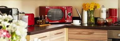 A Red Countertop Microwave In Colorful Kitchen