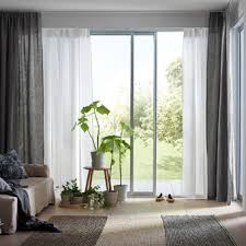 A Light And Airy Living Room With White Gray Layered Curtains