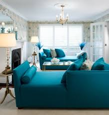 Luxurious Chandelier In Living Room Blue Chaises And Black Fireplace For Gorgeous Interior Design Ideas
