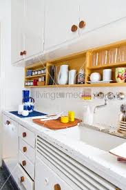 60s Style Kitchen With White Painted Base And Wall Units Wooden Handles Worksurface Crockery Shelf On