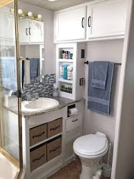 Appealing Rv Remodeling Ideas With White Toilet And Bathroom Cabinet Also Sink Faucet