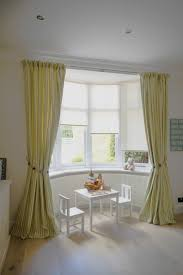 Yellow And Gray Window Curtains by Curtain Yellow Curtains In The Window And Two Vases Of Flowers On