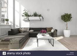 wohnzimmer mit schwarzes sofa neben metall tabelle steht auf