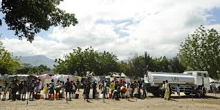 100 Nations Truck FileUS Navy 100125N5345W193 Displaced Haitians Wait In Line For