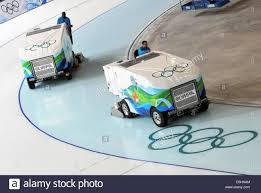 Ice Surfacing Machines Prepare The Track Of Richmond Olympic Oval In ...