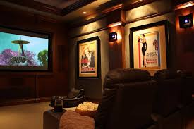 home theater decorated with wall posters and using accent lighting