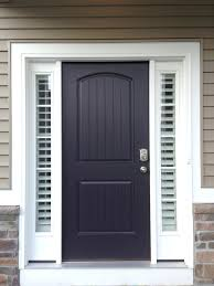 front door with sidelights a glass pane front door framed by